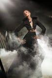 Woman posing in black dress Stock Photo