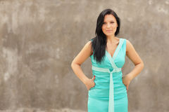 Woman posing in a blue dress Stock Photo