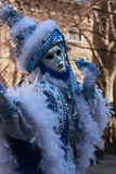 Woman posing in a blue winter costume and mask at the Venice carnival in Italy Royalty Free Stock Photo