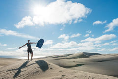 Woman posing with board at Te Paki sand dunes Royalty Free Stock Photography