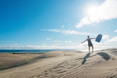 Woman posing with board at Te Paki sand dunes Royalty Free Stock Image