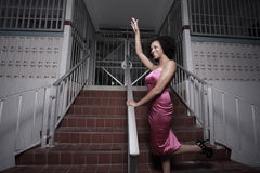 Woman posing by a building Royalty Free Stock Photos