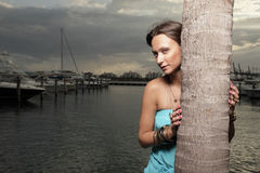 Woman Posing By A Palm Tree Stock Images