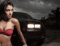 Woman posing by a car Royalty Free Stock Photography