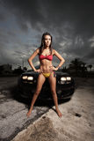 Woman posing by a car Royalty Free Stock Photos