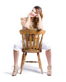 Woman posing on chair Royalty Free Stock Photography