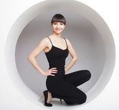 Woman posing in a circle Royalty Free Stock Image