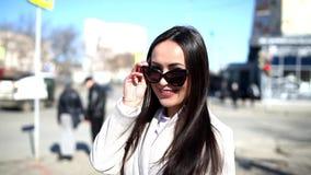 Woman posing on a city street stock video