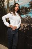Woman Posing in Collard Long-sleeved Shirt and Grey Pants Royalty Free Stock Photography