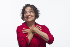 Woman posing comically against white background, horizontal Stock Image