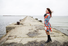 Woman posing at dam at windy day Stock Image