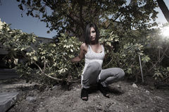 Woman posing in a destroyed garden Stock Images