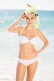 Woman posing with diving mask on beach Royalty Free Stock Images