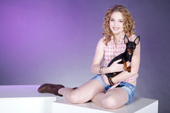 Woman posing with dog on cube Royalty Free Stock Photos