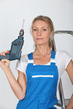 Woman posing with a drill Stock Image