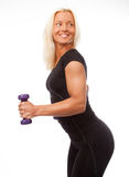 Woman posing with  dumbbells Stock Images