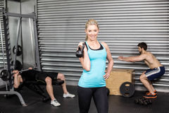 Woman posing with dumbbells Royalty Free Stock Photos
