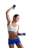 Woman posing with dumbbells in fitness costume Royalty Free Stock Image