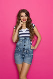 Woman Posing In Dungarees Stock Image