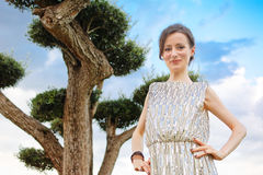 Woman posing with elegant dress with paillettes. Woman posing with elegant dress with paillette Stock Photo