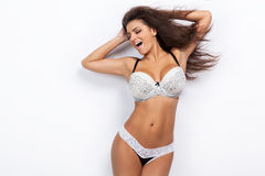 Woman posing in erotic lingerie. Royalty Free Stock Images