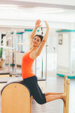 Woman posing and exercising on a ladder barrel Royalty Free Stock Photography