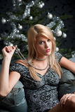 Woman posing in front of Christmas tree royalty free stock photography