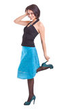 Woman posing in a funky blue dress Royalty Free Stock Photography