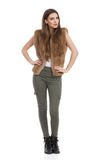 Woman Posing In Fur Waistcoat And Khaki Pants Front View Royalty Free Stock Photo
