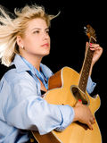 Woman posing with guitar Royalty Free Stock Image