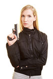 Woman posing with gun royalty free stock photography