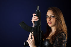 Woman posing with gun Royalty Free Stock Images