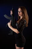 Woman posing with guns Stock Photos