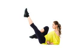 Woman posing in a gym outfit isolated on white background. Stock Image