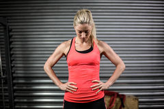 Woman posing with hands on hips Stock Photos