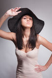 Woman posing in a hat Stock Photo