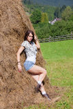 Woman posing at the hay. Young woman in cowboy and countryside style clothers royalty free stock photos