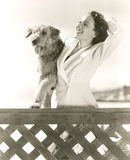Woman posing with her Airedale at the beach royalty free stock photo