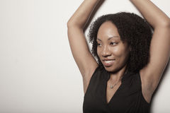 Woman posing with her arms above her head Stock Photography