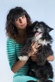 Woman posing with her dog Royalty Free Stock Photography