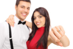 Woman posing with her fiancée and showing a ring Stock Photos