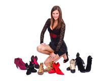 Woman posing with her shoes around Royalty Free Stock Photography