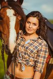Woman posing with horse Stock Images
