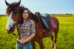Woman posing with horse Royalty Free Stock Images
