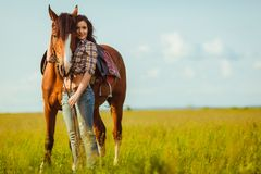 Woman posing with horse Royalty Free Stock Photography