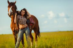 Woman posing with horse Stock Image