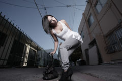 Woman Posing In An Alley Royalty Free Stock Photos