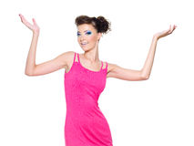 Woman Posing In Pink With Hands Lifted Upwards Royalty Free Stock Photo