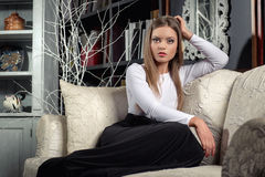 Woman posing indoors Stock Image