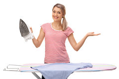Woman posing with an ironing board and an iron Stock Photos